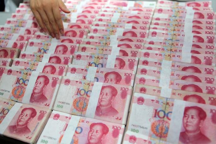 Курс юаня к доллару понижен до годового минимума